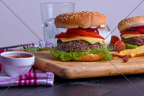 Yummy mega classic burger, tomato and cheese.