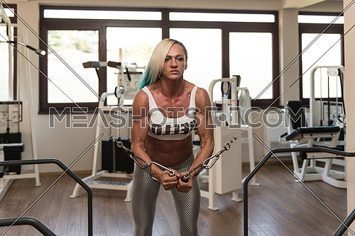 Mature Woman Is Working On Her Chest With Cable Crossover In A Fitness Centar