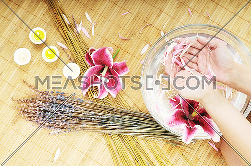 hand  and nail spa and beauty treatment with aroma and flowers in water isolated on white