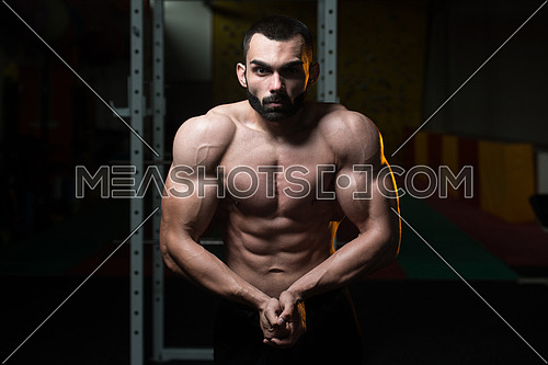 Portrait Of A Young Physically Fit Man Making Most Muscular Pose - Muscular Athletic Bodybuilder Fitness Model Posing After Exercises