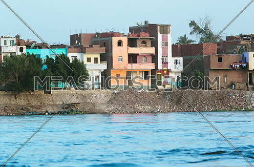 Long shot for Country houses beside river Nile