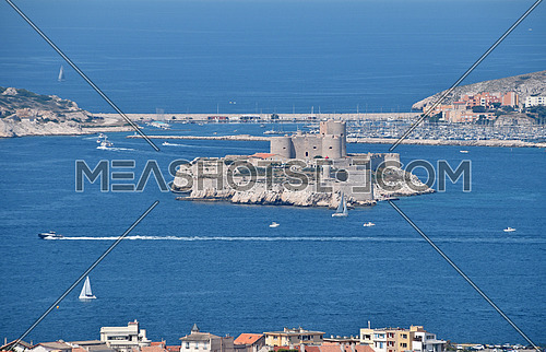 View of Marseille marina and port with the Chateau d'If, famous historical castle prison on island in Marseille bay, high angle view