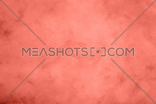 Coral pink color toned paper parchment background texture with stains