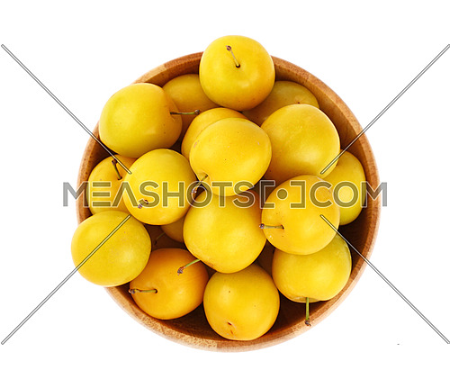 Mellow ripe fresh yellow cherry plums in wooden bowl isolated on white background, close up, top view