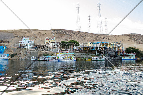 Nile rive in Aswan, Egypt. boats and sand mountains