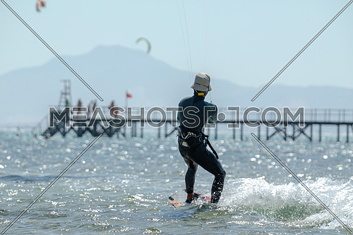 Kite Surfer while surfing in Red Sea at day.