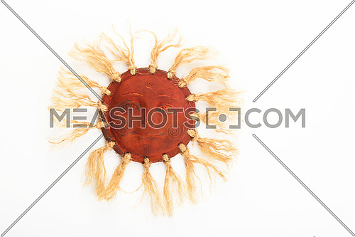 Mexican traditional ceramic happy sun face symbol plate with rays of jute rope isolated on white