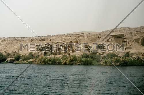 A landscape of the water of Nile river and sand mountains