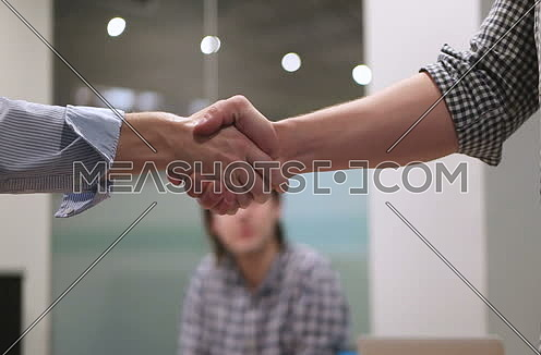 businesswoman in casual clothing shaking hand of partner