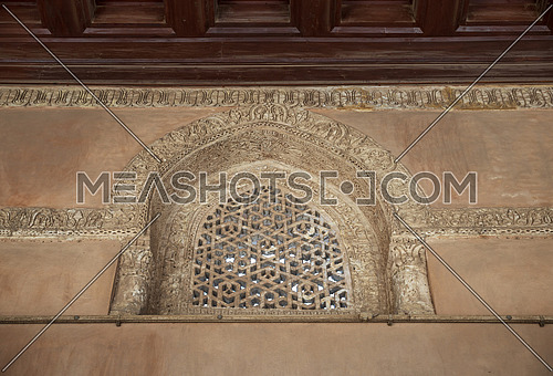 Perforated arched stucco window decorated with geometrical patterns and calligraphy at Ibn Tulun mosque, Old Cairo, Egypt
