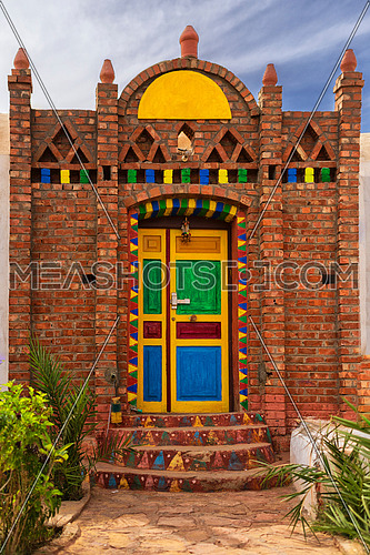 Nubian house painting with different type of colours and already hand building at day.