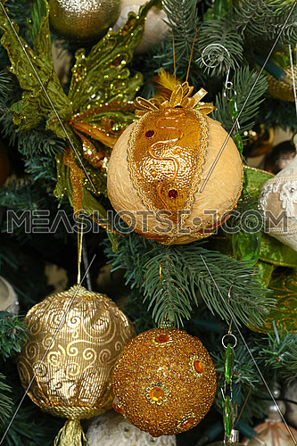 Close up handmade decorations hanging Christmas tree, bows, balls, spheres, front view
