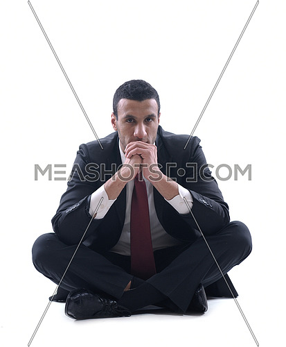 Portrait of a young business man looking depressed from work isolated over white background in studio