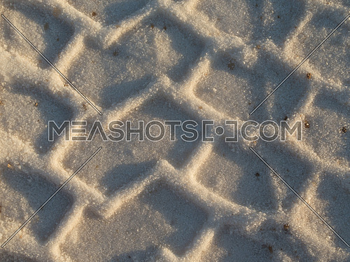 tire tracks on sand