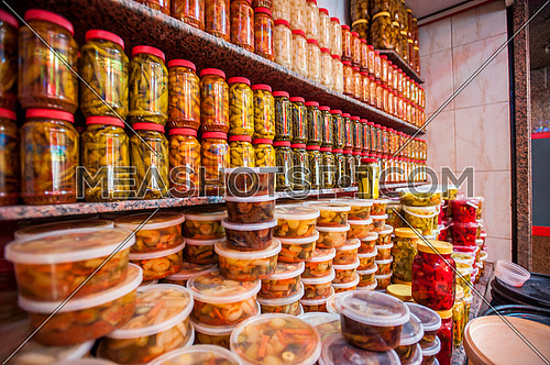 Jars of pickles put on shelves in a small market shop ready to be sold for ramadan  مظاهر شهر رمضان المبارك
