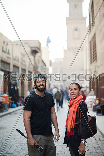 two young beautiful middle eastern tourists enjoy adventures around town