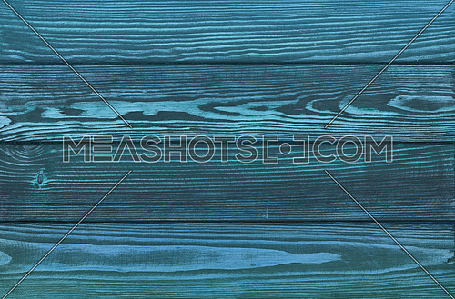 Vintage dark indugo blue wooden planks background texture with scratches and stains over painted weathered wood surface