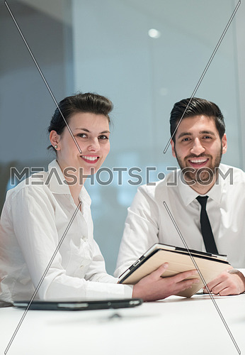 young  business couple portrait at modern bright startup office meeting room  interior