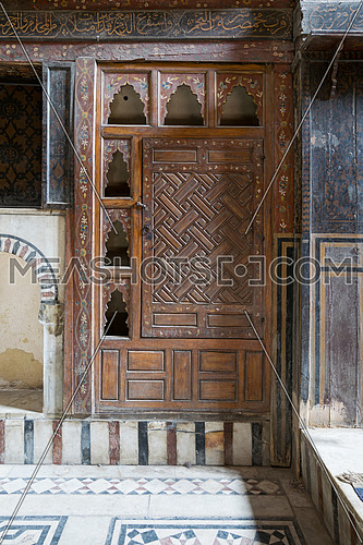 Embedded wooden ornate cupboard, in one of the rooms of El Sehemy house, an old Ottoman era house in Cairo, originally built in 1648