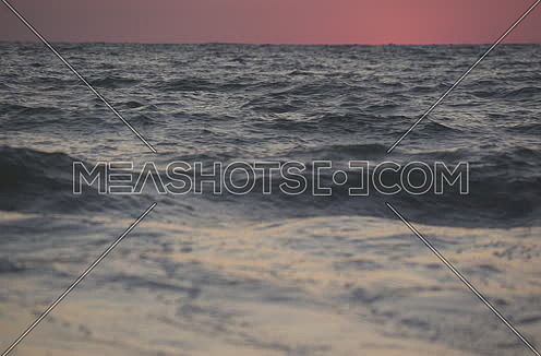 sea waves by sunset