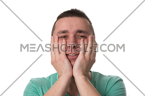 Portrait Of Young Stressed Caucasian Man Covers His Face With Hands Isolated On White Background