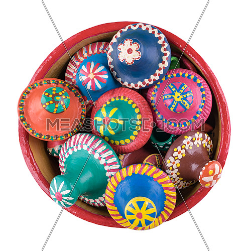 Still life shot showing top view of pottery lids stacked in a pottery bowl isolated on white background