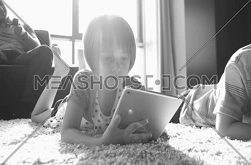 kids playing on floor of modern apartment