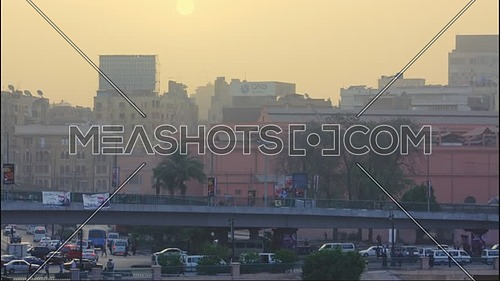 Timelapse  for sunrise and cars go down from the bridge in front the Egyptian museum