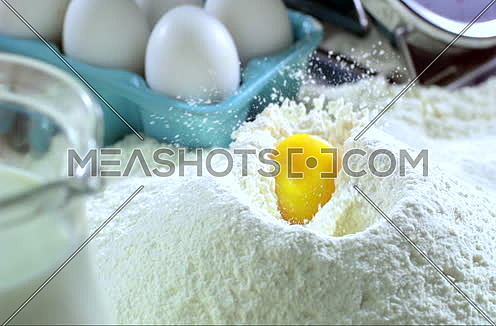 Mid Shot in Slow Motion for an egg falling in Flour