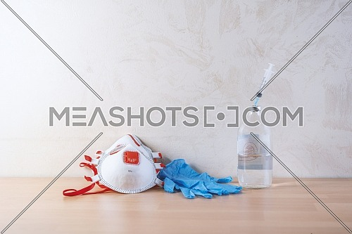 Face Mask,blue medical gloves,syringe inside physiological water ,accessories for protection against Covid-19 or other viruses and infections.concept Coronavirus Vaccine Research