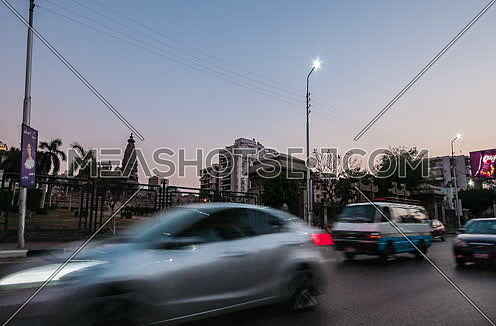 Track Left Shot for Traffic and Le Baron Palace at Salah Salim Street from Day to Night