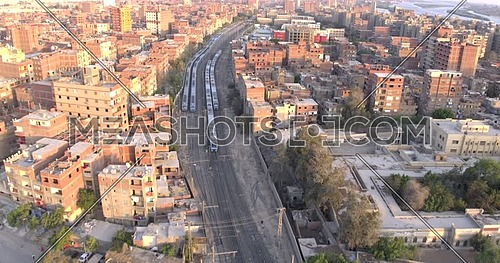 Aerial shot for Railway while Two Metro's are Passing by each other show the Urban in Cairo at day