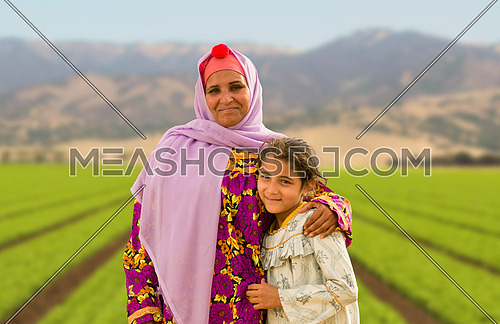 portrait of a women and her daughter in farm