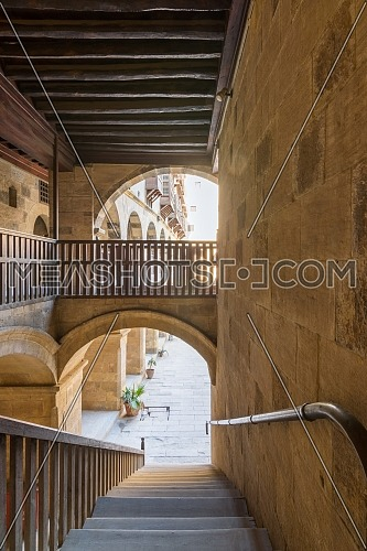 Staircase going down with wooden balustrade at caravansary - Wikala - of Bazaraa, suited in Gamalia district, Medieval Cairo, Egyp