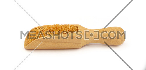 Close up one wooden scoop spoon full of raw brown cane sugar isolated on white background, low angle side view