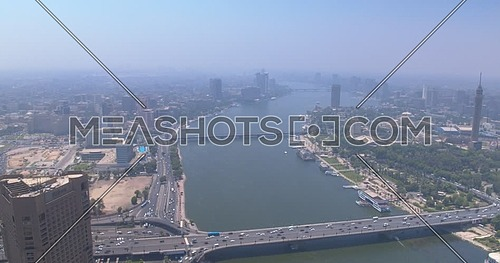 Reveal shot Drone for Cairo City showing The River Nile,Traffic and Bridges in Cairo Downtown at Day