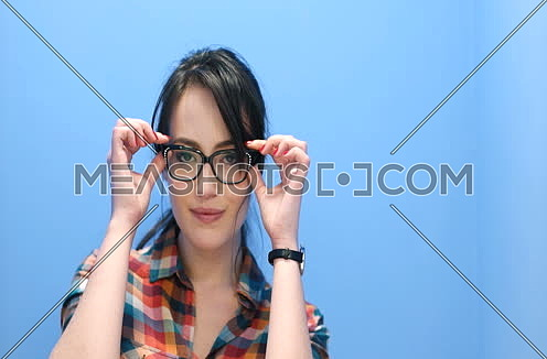 Attractive Young Woman Wearing glasses on colorfull background