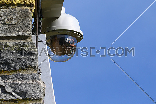 CCTV Security Video Camera on old granite wall