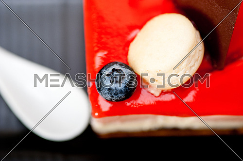 fresh strawberry yogurt mousse with macaroon and blueberry on top