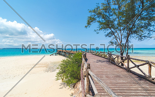 Wooden pier at Prison island near Zanzibar,  Beautiful turquoise water and white sand near Zanzibar, Tanzania