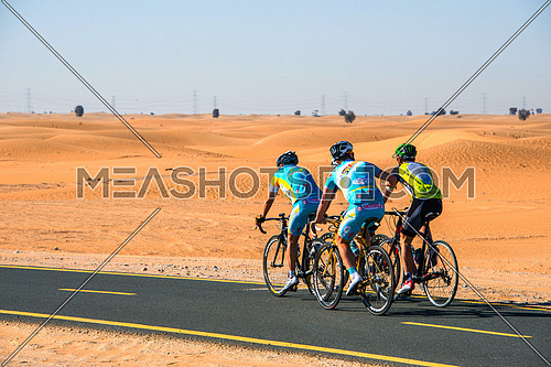 cyclist cycling on a track in the desert  6 February 2016