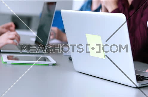 Young Busineswoman Hands Typing On Laptop Computer Keyboard during meeting