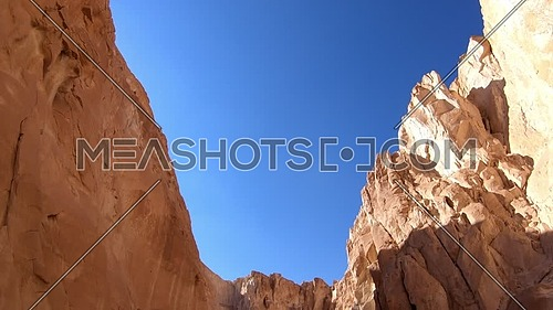 Tilt up shot from inside White Canyon in Sinai at day