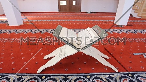 Track in, shot for the Holy Quran in a mosque.