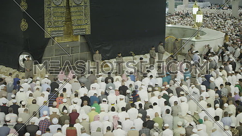 Pan Right for Muslim People praying at Kaaba for Pilgrimage.