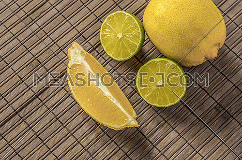 Lemons and limes on textile background