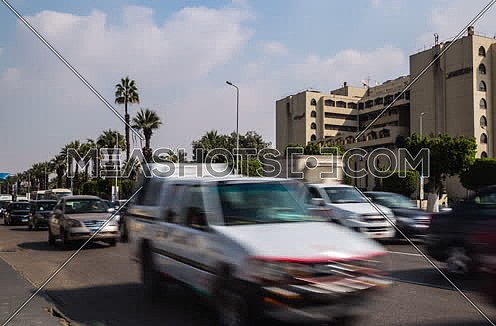 Track Left Shot for traffic at Salah Salim Street showing Le Meridien Hotel in background at Daytime