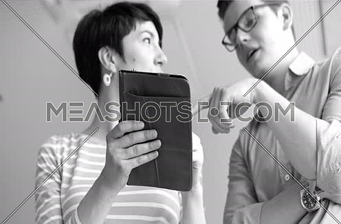 low angle shot of Businessman And Woman Using Digital Tablet