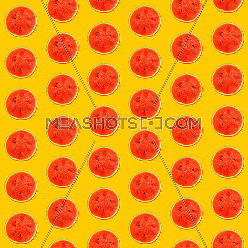 Seamless pattern of fresh red ripe juicy watermelon round cut wedges on vivid yellow background