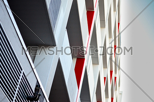 business building with a red wall balcony